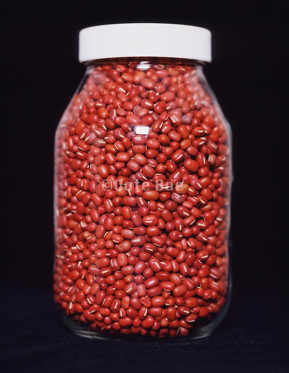 A glass jar with Adzuki beans.