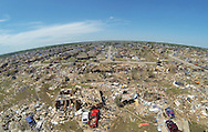 Intact homes (upper left) stand next to totally destroyed dwellings showing the path of the May 20, 2013 tornado in Oklahoma City, Oklahoma May 22, 2013.  Rescue workers with sniffer dogs picked through the ruins on Wednesday to ensure no survivors remained buried after a deadly tornado left thousands homeless and trying to salvage what was left of their belongings. Curvature of horizon in the photo is due to an ultra-wide angle lens.  REUTERS/Rick Wilking (UNITED STATES)