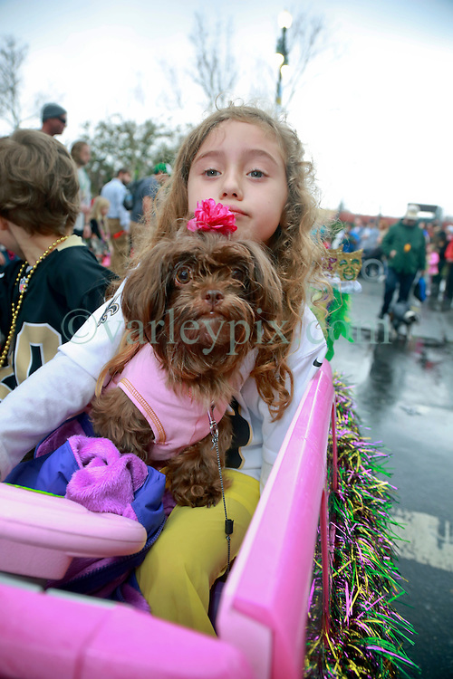 """23 Feb 2014. New Orleans, Louisiana.<br /> Lucy Walker and dog Lilly on the wet and soggy streets of the French Quarter at the 22nd Mystic Krewe of Barkus parade, the only officially licensed Mardi Gras krewe by and for canines. This year's parade is themed  """"Dogzilla: Barkus Licks the Crescent City."""" <br /> Photo; Charlie Varley/varleypix.com"""
