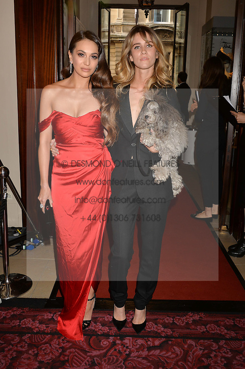 Left to right, ZARA MARTIN and JADE WILLIAMS at the GQ Men Of The Year 2014 Awards in association with Hugo Boss held at The Royal Opera House, London on 2nd September 2014.