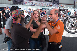 """Steve """"Beatnik"""" Werner with Michael Lichter and Catherine at the Naked Truth exhibition's industry party at the Buffalo Chip gallery during the 75th Annual Sturgis Black Hills Motorcycle Rally.  SD, USA.  August 5, 2015.  Photography ©2015 Michael Lichter."""