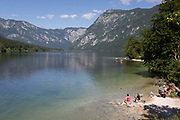 Visitors to Slovenia enjoy the view from the bridge at Ribcev Laz, on 19th June, in Lake Bohinj, Sovenia.