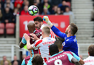 goalkeeper Jack Butland of Stoke city  punches the ball away from Andre Ayew of West Ham . Premier league match, Stoke City v West Ham Utd at the Bet365 Stadium in Stoke on Trent, Staffs on Saturday 29th April 2017.<br /> pic by Bradley Collyer, Andrew Orchard sports photography.