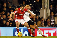 Ryan Fredericks of Fulham (R) battles with Gary Gardner of Barnsley (L). EFL Skybet championship match, Fulham v Barnsley at Craven Cottage in London on Saturday 23rd December 2017<br /> pic by Steffan Bowen, Andrew Orchard sports photography.