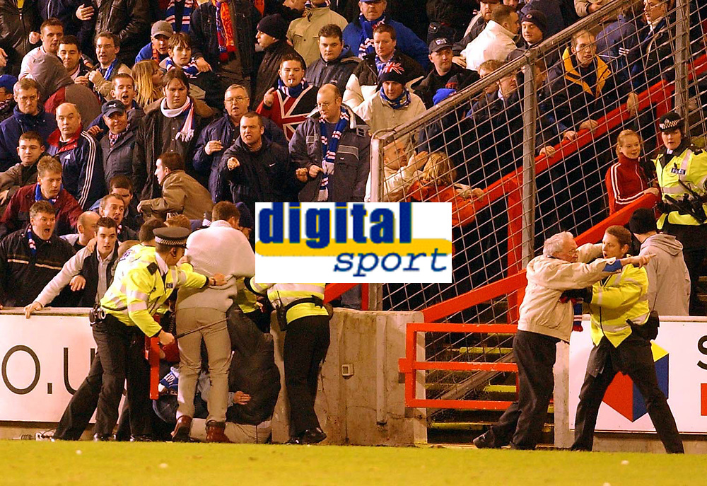 Fotball: Aberdeen v Rangers, Scottish Premier League. Pittodrie. Saturday January 19th.  2002. Referee Mike McCurry takes the players off  after crowd trouble.<br /><br />Foto: Ian Stewart, Digitalsport