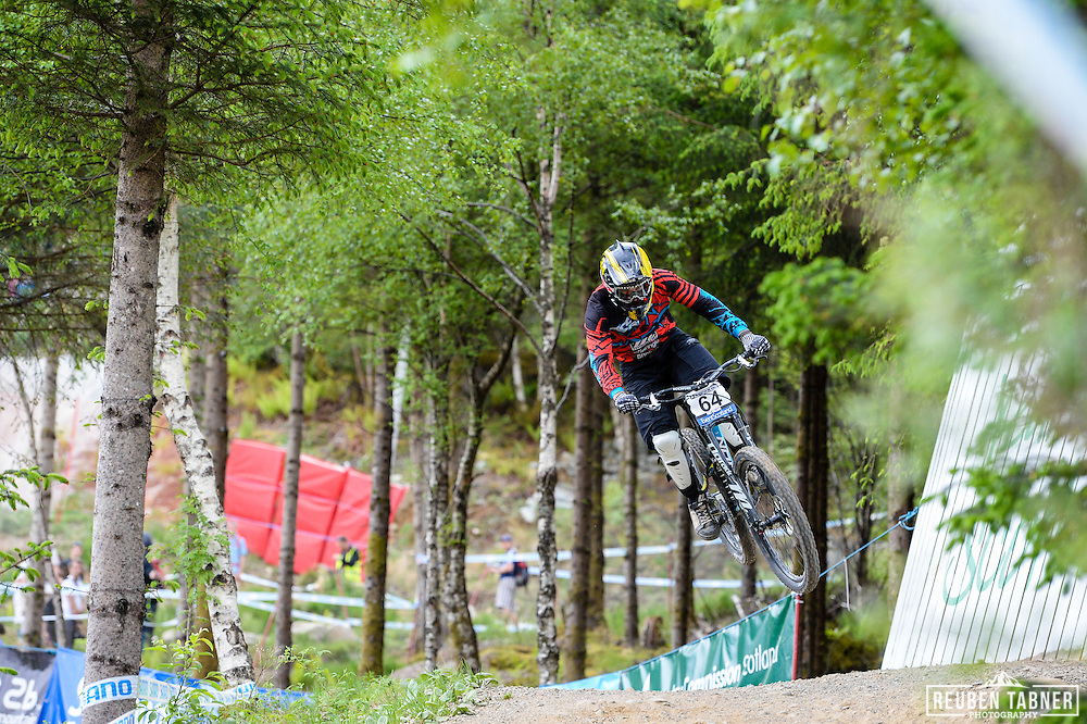 09.06.2013 Fort William, Scotland. Ben Reid of Dirt Norco Race Team during the Men's Elite Downhill  Final for the UCI Mountain Bike World Cup in Fort William.