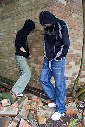 Two teenagers hanging around on the street,