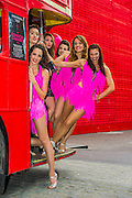 Dancers from the London Cabaret Club take a bus to the Southbank in an attempt to cheer up commuters who are suffering on a tube strike day. The Southbank, London, UK 29 April 2014.