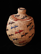 Yupik grass basket with flying sandhill cranes woven by Susanna Chanar of Toksook Bay, Alaska.  (10 x 8 inches)  (Please note:  Licensing of this photo requires a license and additional fee to be paid to the basket's creator, Susanna Chanar)