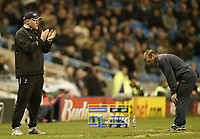 Photo: Aidan Ellis.<br /> Manchester City v Tottenham Hotspur. The Barclays Premiership. 17/12/2006.<br /> City's Boss Stuart Pearce cant watch as his side lose to Spurs whilst Martin Jol Applauds his team