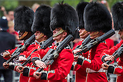 Guardsmen and their bands march down the Mall - Queens 90th birthday was celebrated by the traditional Trooping the Colour as well as a flotilla on the river Thames.