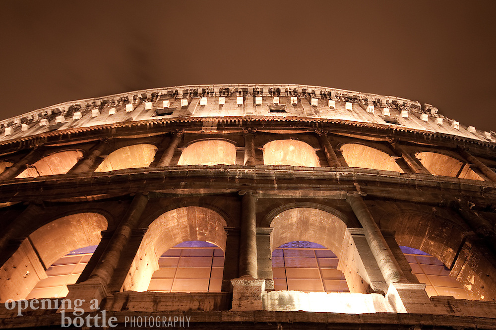The Roman Coliseum glows from within, as seen from directly below the entrance. Rome, Lazio, Italy. Full color version upon request.