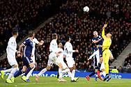 Scotland defender Scott McKenna (5) (Aberdeen) goes up to challenge Ariel Harush (1) (Hapoel Be'er Sheva)of Israel during the UEFA Nations League match between Scotland and Israel at Hampden Park, Glasgow, United Kingdom on 20 November 2018.