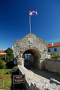 Donja Vrata, the Lower Gate, with Croatian national flag flying. Nin, Croatia