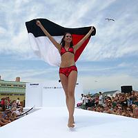 (PFEATURES)  Pt. Pleasant 7/19/2003  Tommy Hilfiger fashion show on the beach in Pt. Pleasant.   Patti Martin will ID.  Michael J. Treola Staff Photographer.....MJT