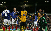Photo: Lee Earle.<br /> Portsmouth v Wigan Athletic. The Barclays Premiership. 05/11/2005. Wigan's Pascal Chimbonda (C) celebrates his opening goal as Portsmouth keeper Jamie Ashdown (R)  and players look dejected.