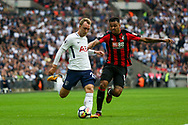 Christian Eriksen of Tottenham Hotspur holds off Josh King of AFC Bournemouth.<br /> Premier league match, Tottenham Hotspur v AFC Bournemouth at Wembley Stadium in London on Saturday 14th October 2017.<br /> pic by Kieran Clarke, Andrew Orchard sports photography.