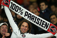 a Paris Saint Germain fan holds up his ' 100% Parisien scarf ' before k/o. UEFA Champions league group A match, Arsenal v Paris Saint Germain at the Emirates Stadium in London on Wednesday 23rd November 2016.<br /> pic by John Patrick Fletcher, Andrew Orchard sports photography.
