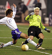 10 February 2006: US goalkeeper Kevin Hartman (right) barely clears the ball away from Japan's Hisato Sato (left). The United States Men's National Team defeated Japan 3-2 at SBC Park in San Francisco, California in an International Friendly soccer match.