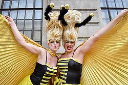 © Licensed to London News Pictures. 08/07/2017. London, UK. Drag queens wear elaborate bee-inspired costumes.  Tens of thousands of visitors, many wearing eye-catching costumes, gather to watch and take part in the annual Pride in London Parade, the largest celebration of the LGBT+ community in the UK.   Photo credit : Stephen Chung/LNP