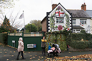 The Jelley's family home in Birmingham, adorned with emblems of white right wing nationalism, English flags, and images of St George. A very nationalistic and patriotic family known for a history of intimidation and abuse with links to the British National Party.