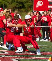 """The Senior class backs up Tyler Richter in the """"tug of war"""" during Laconia High School's Pep Rally for Homecoming Friday afternoon.  (Karen Bobotas/for the Laconia Daily Sun)"""