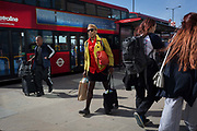 Commuters and other pedestrians walk over London Bridge, the oldest of the capitals crossing over the river Thames between the capitals financial district, the City of London, and Southwark on the south bank, on 17th May 2018, in London, UK.