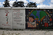 Murals painted by different organizations and artists on the fence surrounding the Historic National Police Archives. On July 5, 2005, the historical archives of the now dissolved National Police were found in an abandoned arms depot in the outskirts of Guatemala City. The discovery of these millions of documents, which were allegedly lost after the 1996 Peace Accords, provide important evidence in the search for the thousands of people who were detained and subsequently disappeared by State security forces during the internal armed conflict (1960-1996). Guatemala City, Guatemala. December 13, 2011.