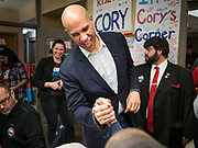 19 DECEMBER 2019 - URBANDALE, IOWA: US Senator CORY BOOKER (D-NJ) shakes hands with a volunteer at his presidential campaign headquarters in Urbandale, a suburb of Des Moines. Sen. Booker, who did not qualify for the December 19 debate in Los Angeles, campaigned in the Des Moines area Thursday and visited the phone bank at his Iowa campaign headquarters. Iowa traditionally holds the first event of the presidential election cycle. The Iowa caucuses at Feb. 3, 2020.              PHOTO BY JACK KURTZ