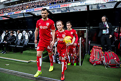 Bailey Wright of Bristol City and the mascot walk out - Rogan Thomson/JMP - 25/02/2017 - FOOTBALL - St James' Park - Newcastle, England - Newcastle United v Bristol City - Sky Bet EFL Championship.