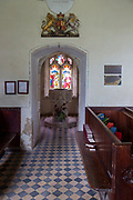 Historic interior of Washbrook church, Suffolk, England, UK - baptistery doorway