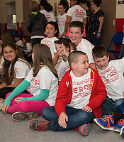 Pleasant Street School students waiting for a special announcement during their assembly on Friday morning.  (Karen Bobotas/for the Laconia Daily Sun)