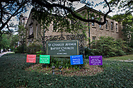 Signs about how to deal with the coronavirus pandemic in front of the St. Charles Avenue Baptist Church in New Orleans.