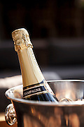 Champagne chilled in an ice bucket at Abu Camp, a luxury safari camp in the Okavango Delta, Botswana