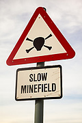 'Slow minefield' road sign outside Port Stanley, thousands of landmines were laid by Argetine forces during 1982 Argentian British conflict, Falkland Islands