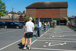 "© Licensed to London News Pictures. 09/05/2020. LONDON, UK.  Customers queue to enter a Waitrose supermarket in Northwood, north west London during the coronavirus pandemic lockdown.  The supermarket chain, alongside other supermarkets, has a controlled entry system into their stores requiring customers to queue at a 2 metre safe distance.  Boris Johnson, Prime Minister, is due to deliver a ""roadmap"" speech on Sunday 10 May to unveil the governments plans on lifting lockdown restrictions.  Photo credit: Stephen Chung/LNP"