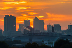 Primrose Hill, London, October 28th 2016. The distant skyscrapers of Docklands create a silhouette against the sky moments before sunrise as dawn breaks over London.