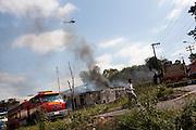 Contagem_MG, Brasil...Acidente envolvendo um caminhao da CEMIG e um caminhao tanque em Contagem. Na foto bombeiros apagando o incendio...An accident involving a CEMIG truck and a tank truck in Contagem. In this photo firemen putting out the fire...Foto: LEO DRUMOND / NITRO