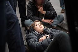 © Licensed to London News Pictures. 07/10/2019. London, UK. Extinction Rebellion (XR) activists are arrested on Westminster Bridge after bolting themselves to street furniture and makeshift obstacles. Photo credit: Guilhem Baker/LNP