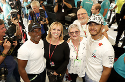 November 3, 2019, Austin, United States of America: Motorsports: FIA Formula One World Championship 2019, Grand Prix of United States, ..#44 Lewis Hamilton (GBR, Mercedes AMG Petronas Motorsport) celebrates winning the F1 World Drivers Championship 2019 with Anthony Hamilton, Linda Hamilton and his mother Carmen  (Credit Image: © Hoch Zwei via ZUMA Wire)
