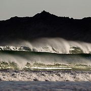 The surf rolls in at Wainui Beach, near Gisborne. Wainui beach is world famous as a surfing beach, it's fantastic breaks and it's beautiful stretch of sand and sea..Wainui Beach, Gisborne, Hawkes Bay, New Zealand,, 15th January 2011. Photo Tim Clayton.