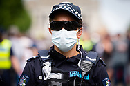 A PORT officer is seen standing ground against demonstrators during the Freedom protest on October 23, 2020 in Melbourne, Australia. Freedom protests are being held in Melbourne in response to the governments COVID-19 restrictions and continuing removal of liberties despite new cases being on the decline. Victoria recorded a further 1 new cases overnight along with no deaths recorded.(Photo by Mikko Robles/Speed Media)
