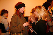 JULIE VERHOEVEN AND VIRGINIA DAMSTA. Private View of Space Invader by Florian Balze in Cooperation with the Riflemaker Gallery. German Embassy. 27 March 2006. ONE TIME USE ONLY - DO NOT ARCHIVE  © Copyright Photograph by Dafydd Jones 66 Stockwell Park Rd. London SW9 0DA Tel 020 7733 0108 www.dafjones.com