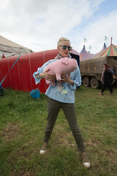 Tilda Swinton posing for photos back stage at the Pilton Palais cinema tent holding a toy pig to promote OKja, a South-Korean American Netflix film. Swinton is co-curator of this year's cinema programme.Taken on Day 1 (Friday) of the 2017 Glastonbury Festival at Worthy Farm in Somerset. Photo date: Friday, June 23, 2017. Photo credit should read: Richard Gray/EMPICS Entertainment