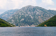 The narrow straight between Kamenari and Lepetani, view towards Perast and an impressive mountain top falling down to the sea bay Kotorski Montenegro, Balkan, Europe.
