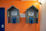 Two wing pin phones side by side on a wing inside HMP Bronzefield, a private prison run by Sodexo Justice Services on the outskirts of Ashford in Middlesex, United Kingdom. HMP Bronzefield is an adult and young offender female prison, the only purpose built private prison solely for women in the UK and is the largest female prison in Europe. (photo by Andy Aitchison)