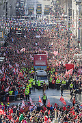Sunday March 23rd 2014, Aberdeen, Scotland. Thousands of Dons supporters watch an open-top bus carrying the team from Albyn Place, down along Union Street to the Town House.  It follows Aberdeen beating Inverness 4-2 in a penalty shoot out in Glasgow at Parkhead last weekend in the Final of the Scottish League Cup.<br /> <br /> (Photo Ross Johnston/Newsline Scotland)