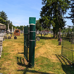 "Carlisle, PA – June 26, 2016: The Mary Ludwig Hays - better known as Molly Pitcher - gravesite, located in the Old Graveyard Cemetery, includes a statue of ""Molly"" standing alongside a cannon."
