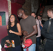ROSARIO DAWSON; KOFI DEBRAH; , West End opening of RSC production of Julius Caesar at the Noel Coward Theatre on Saint Martin's Lane. After-party  at Salvador and Amanda, Gt. Newport St. London. 15 August 2012.