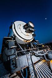 Old railroad train engine at dusk, Grapevine, Texas USA